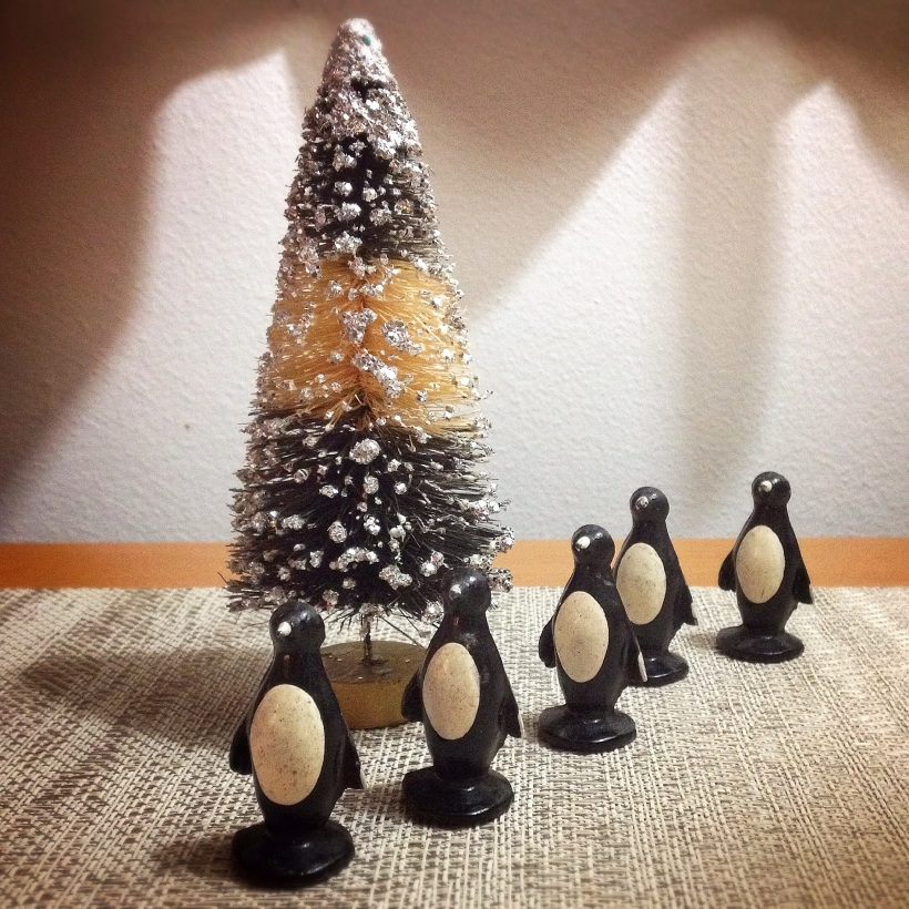 The old lead penguin toys found the perfect vintage bottle brush tree.
