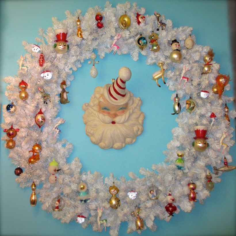 Giant white wreath with vintage Italian and West German ornaments. A very unusual, plaster, 1950's Santa Claus store display watches over the menagerie.